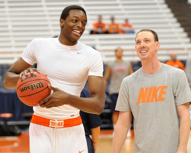 Guard Jerami Grant with Syracuse basketball great, Jerry MacNamara