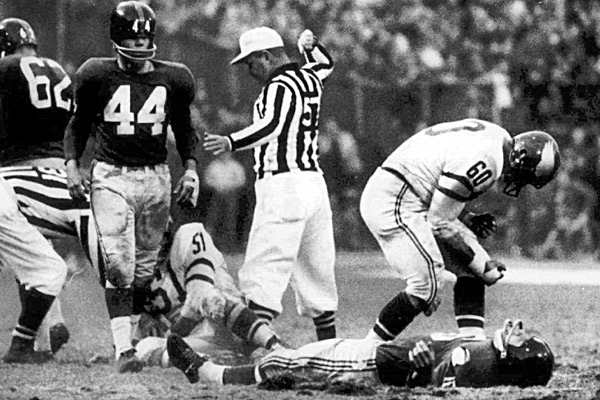 Frank Gifford (on ground), Chuck Bednarik  photo:cbssports.com