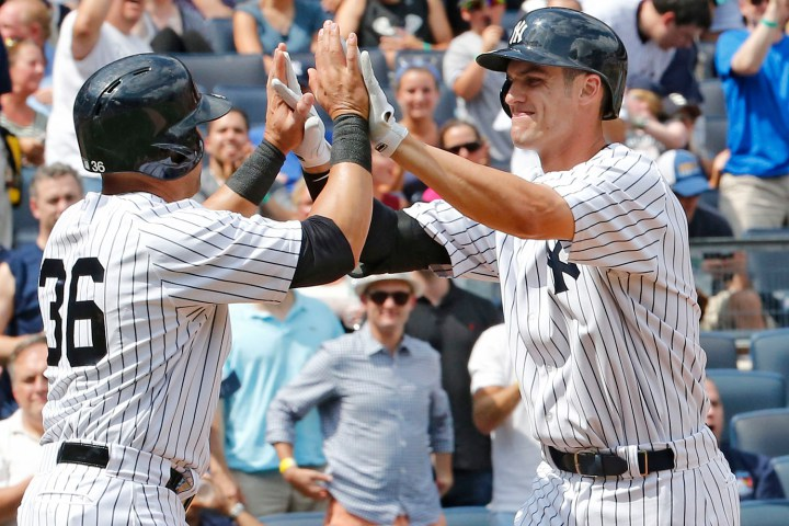 Carlos Beltran High 5's Greg Bird After He Hit His 1st Major League HR  photo:paul j. bereswill