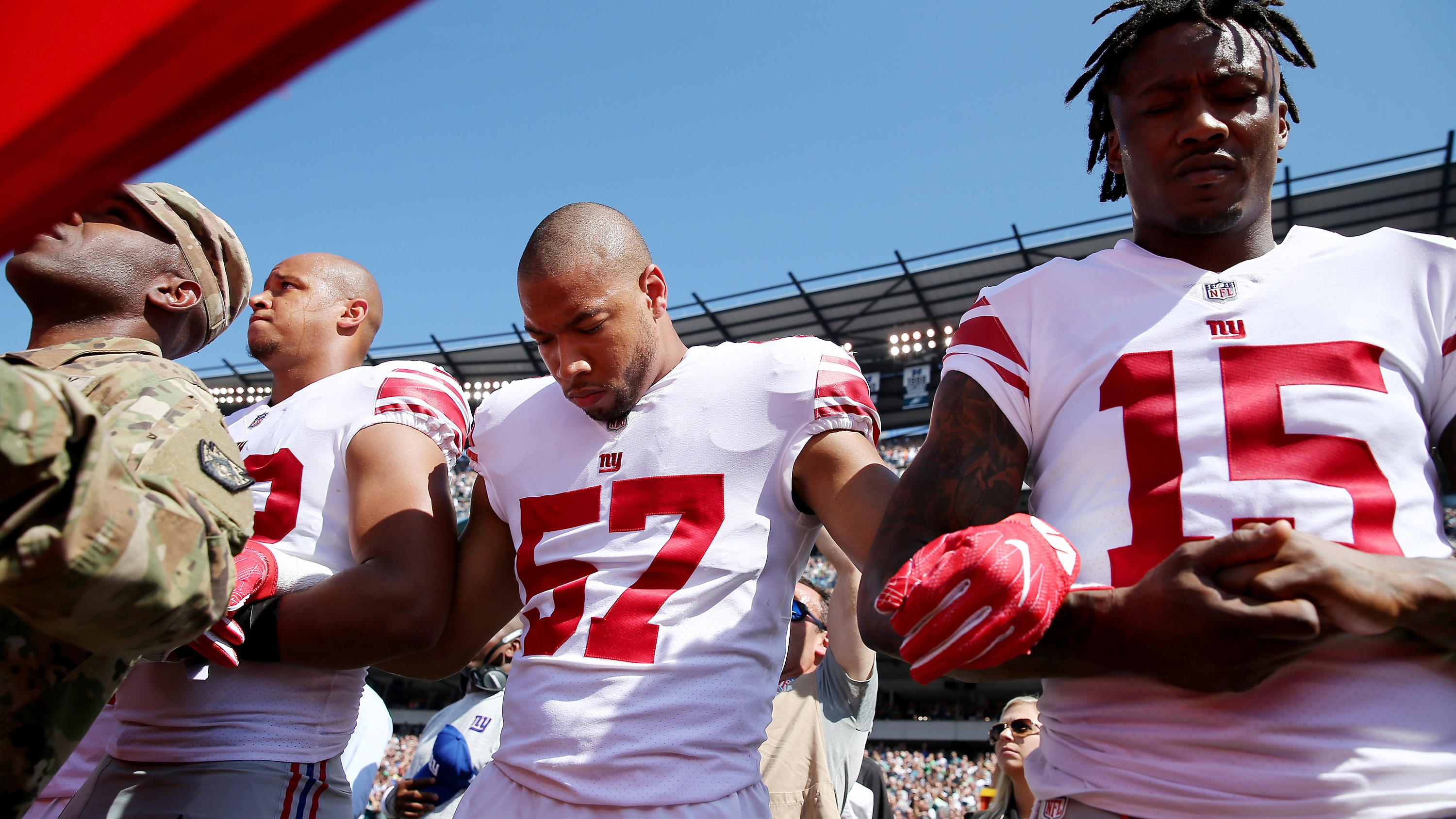 NFL Players Linking Arms in Solidarity Against Trump…
