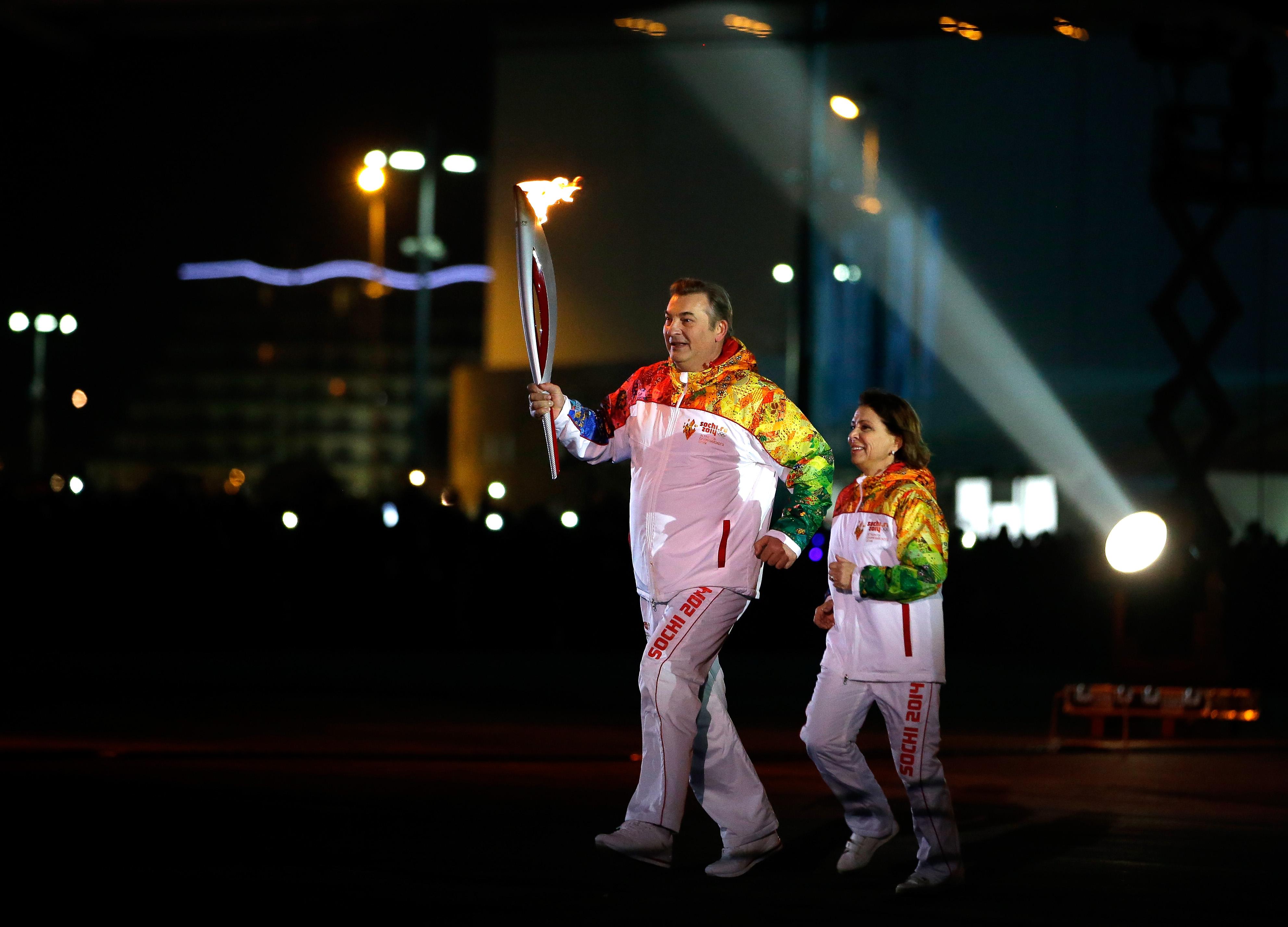 Irina Rodnina and Vladislav Tretiak Lighting Olympic Torch/NBS Sports
