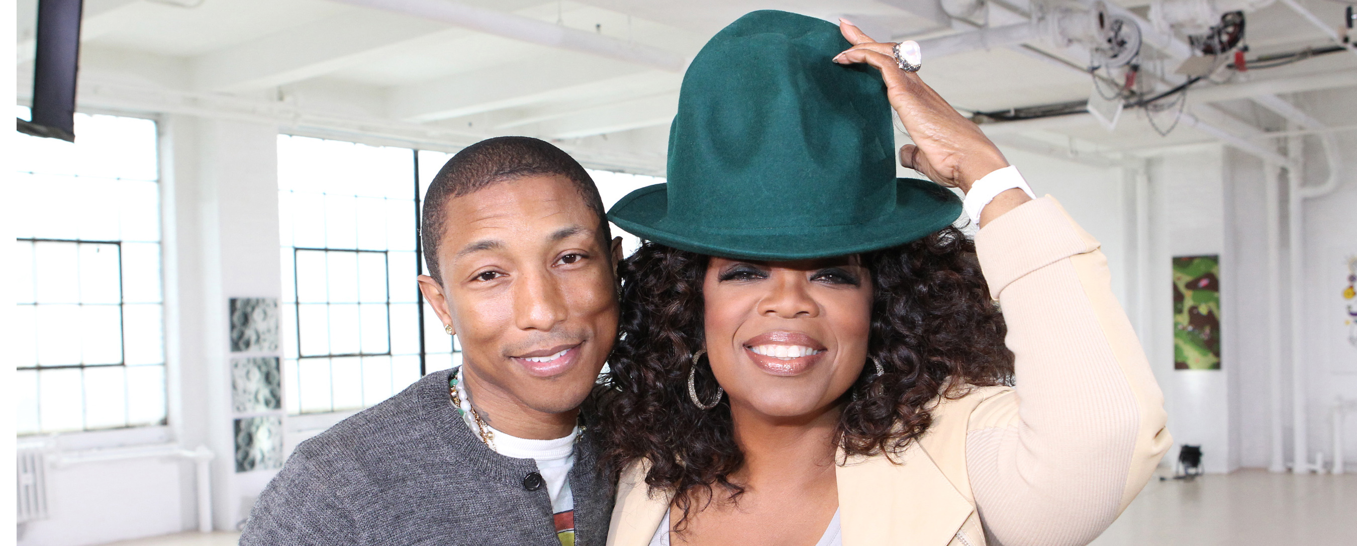 Pharrell with Oprah and His Trademark Vivienne Westwood Hat